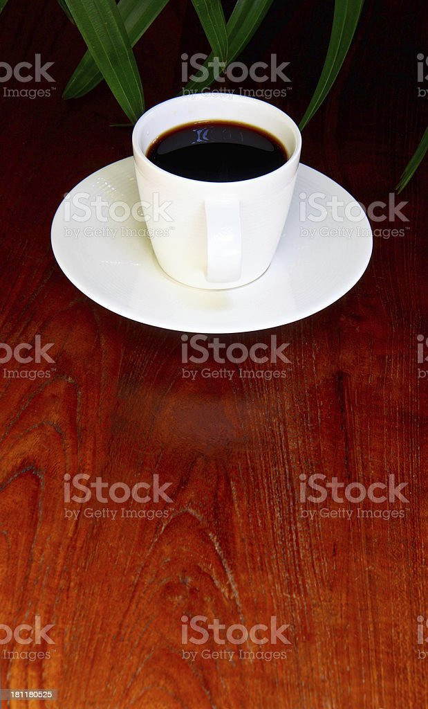 Cup of coffee on the wooden floor. royalty-free stock photo