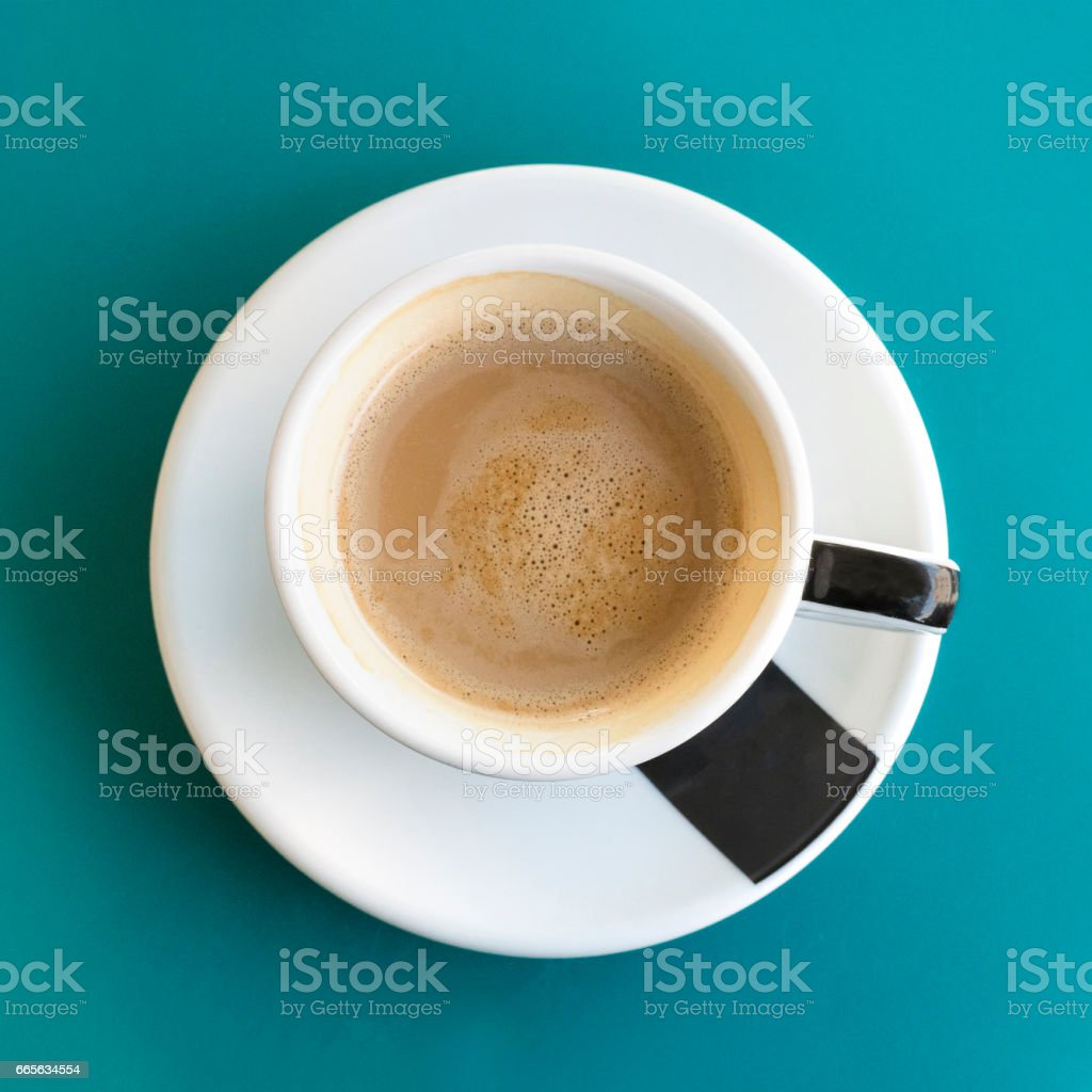 Cup of coffee on turquoise with copyspace stock photo