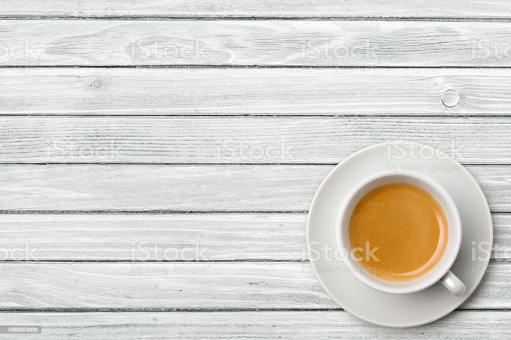 Cup of coffee on weathered white table stock photo