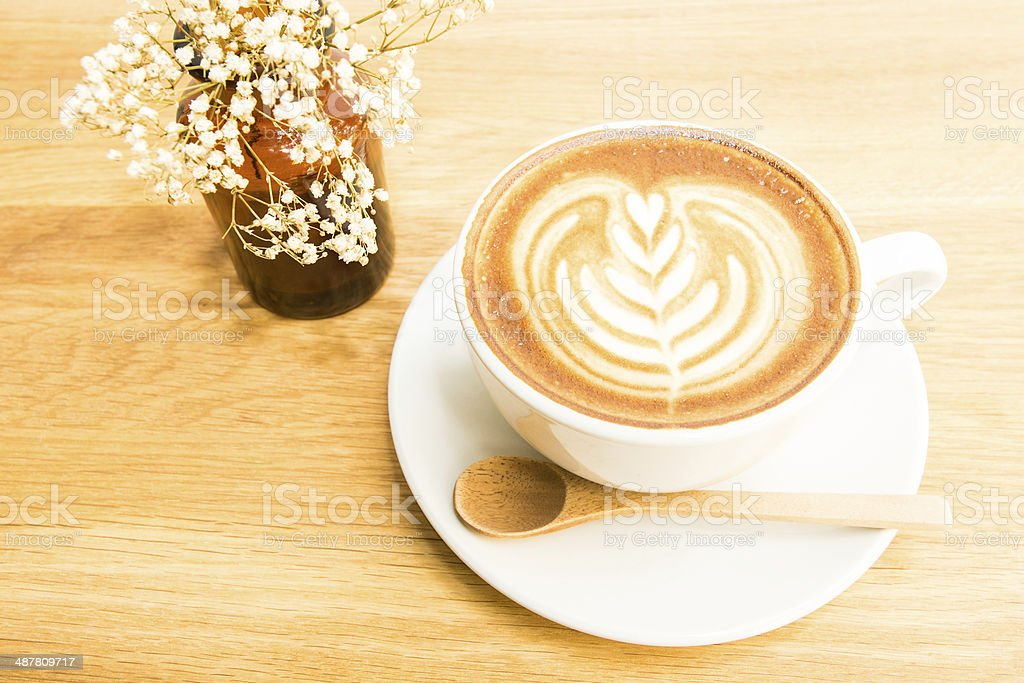 cup of coffee on wood background royalty-free stock photo