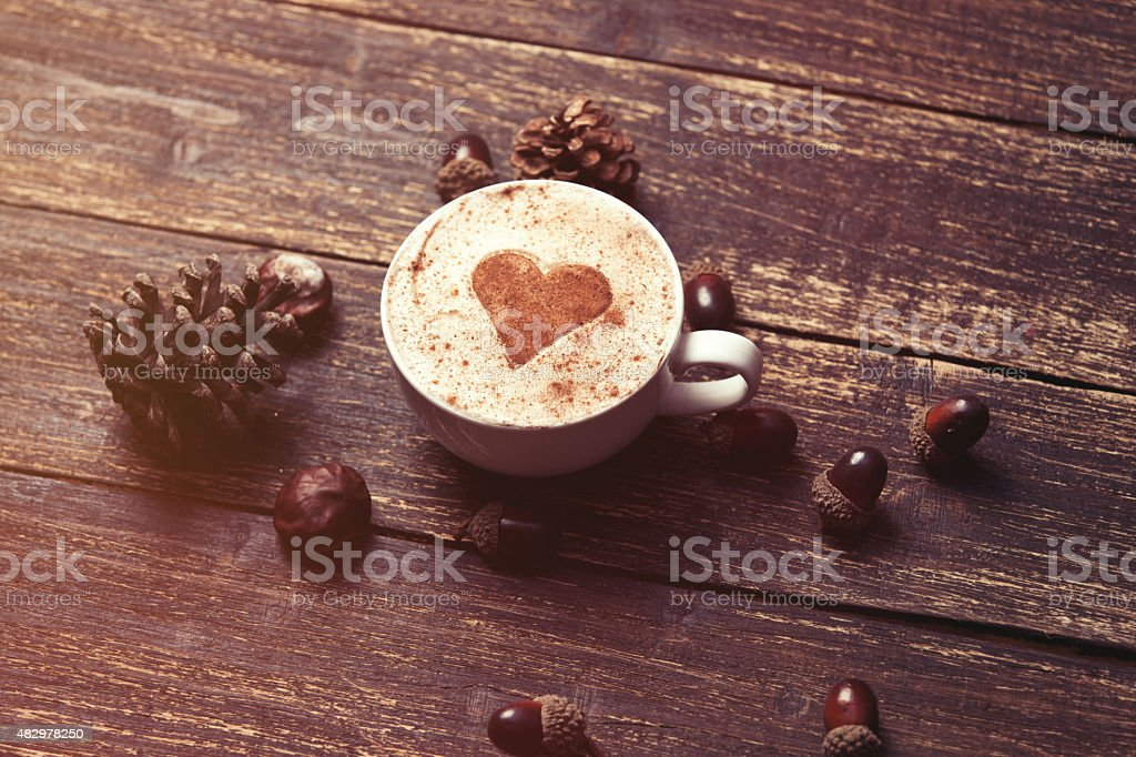Cup of coffee on wooden background stock photo