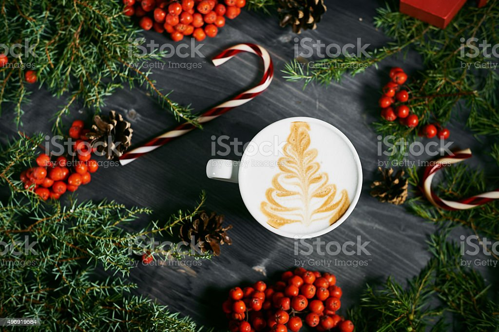 Cup of coffee on wooden christmas background stock photo