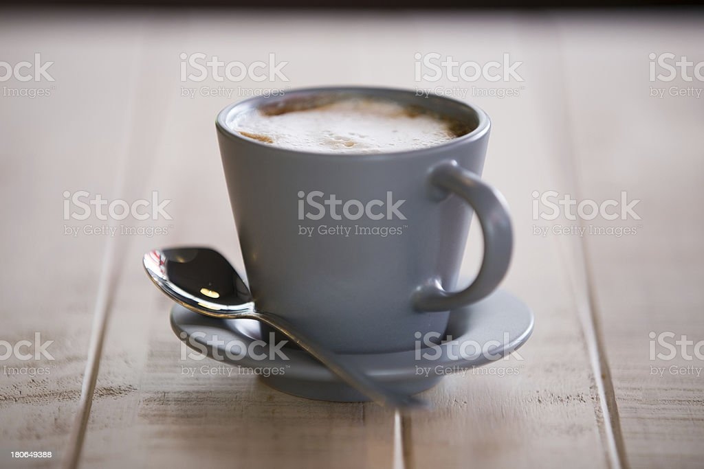Cup of coffee on wooden royalty-free stock photo