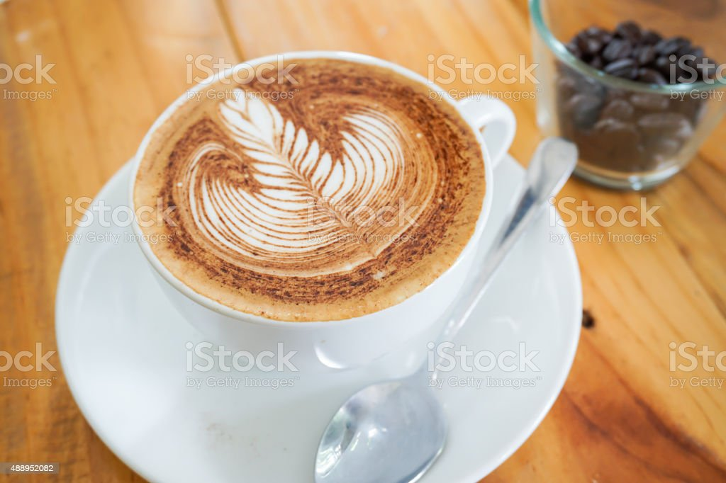 Cup of Coffee on wooden table. stock photo
