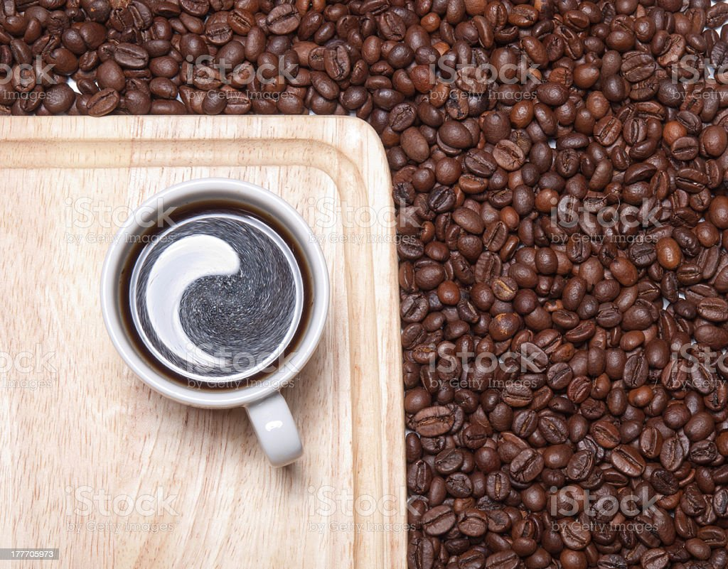 Cup of coffee on wooden table with coffe beans royalty-free stock photo