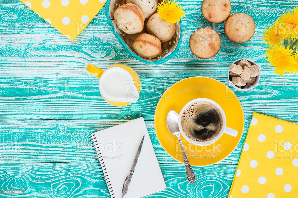 cup of coffee on yellow plate and yellow milk jug stock photo