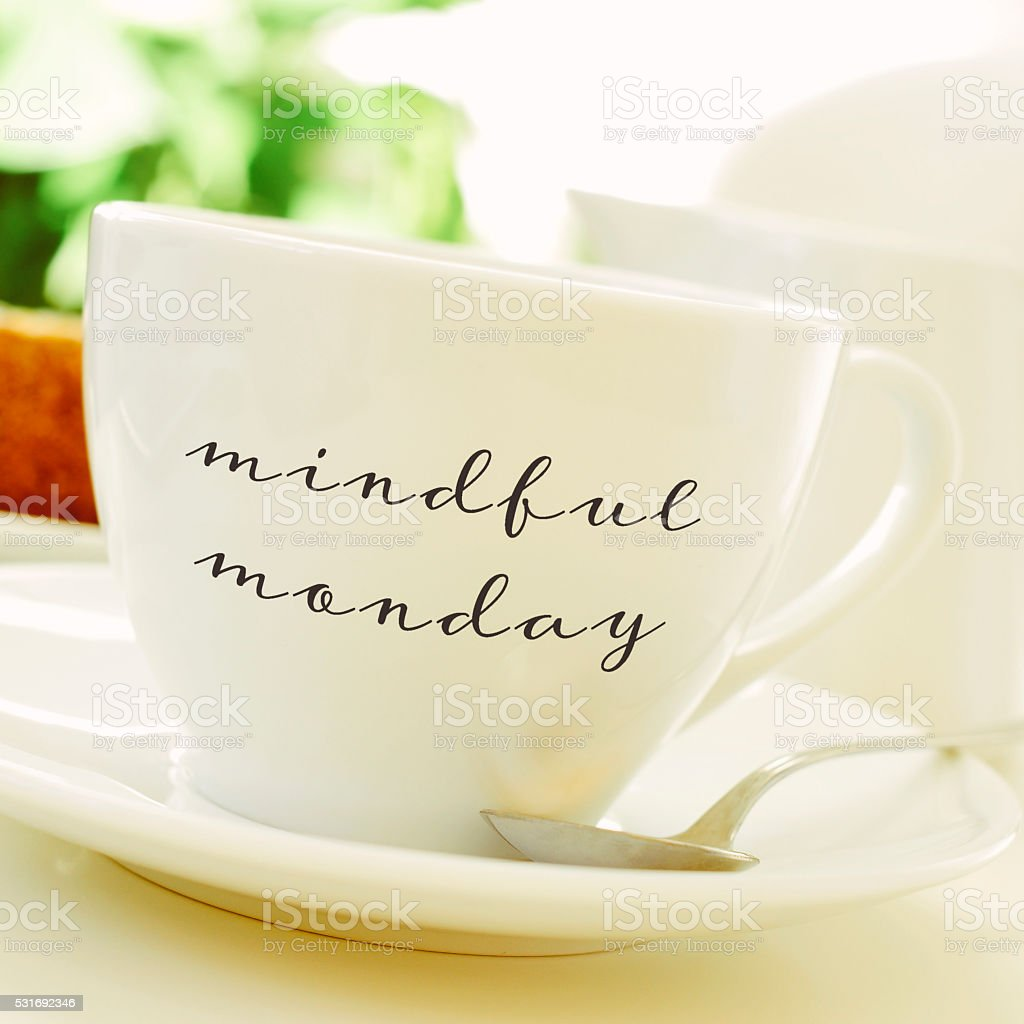cup of coffee or tea with the text mindful monday stock photo