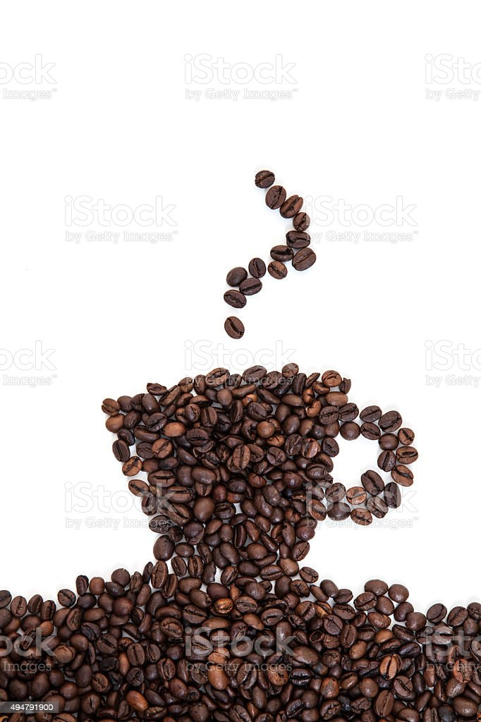 Cup of coffee out of roasted coffee beans stock photo
