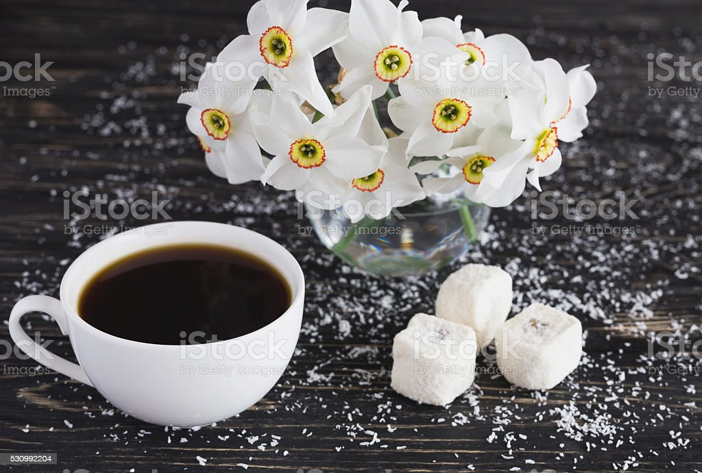 Cup of coffee, Rahat lokum with coconut and narcissus stock photo