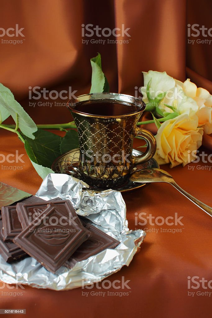 Cup of coffee, roses and chocolate bar. stock photo