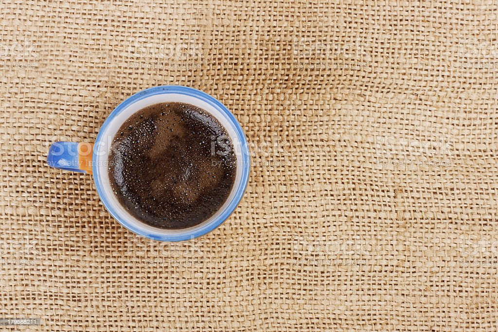 cup of coffee standing on sackcloth royalty-free stock photo