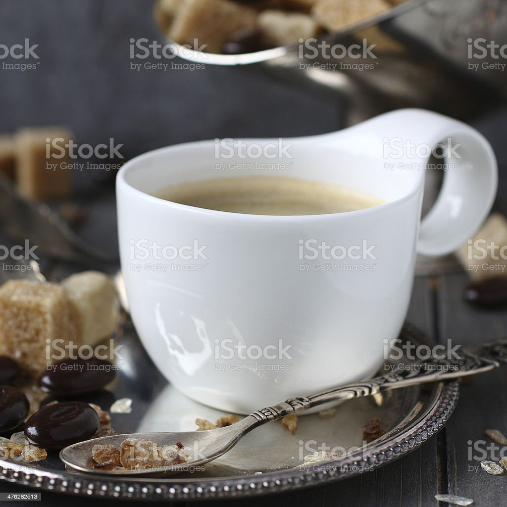 Cup of coffee, sugar cubes and chocolate candy royalty-free stock photo