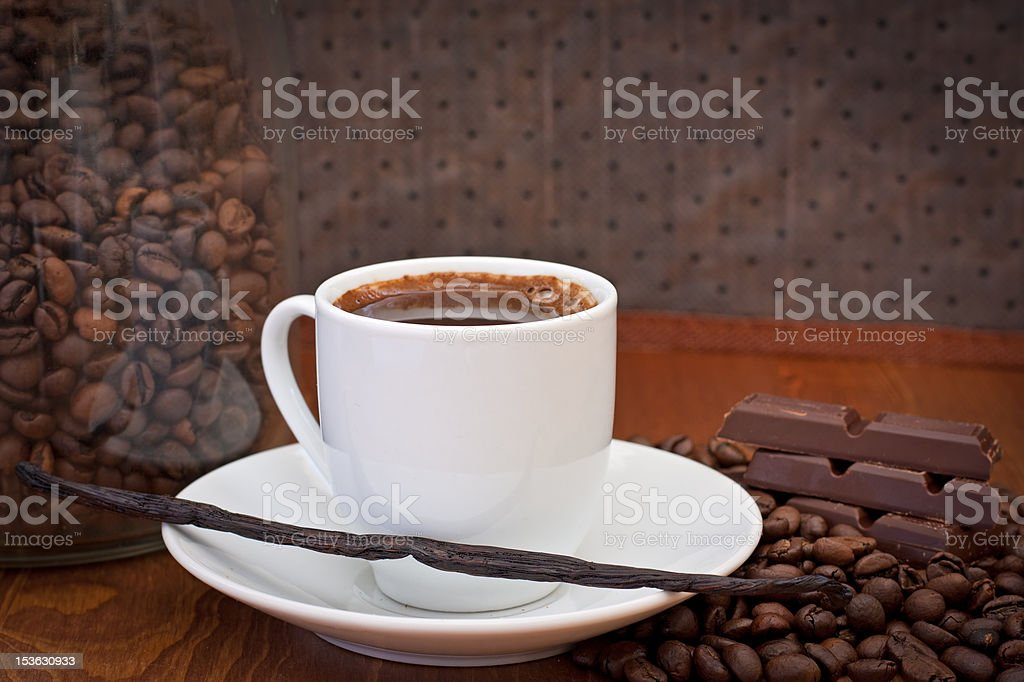 cup of coffee, vanilla bean and chocolate royalty-free stock photo