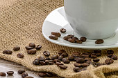 Cup of coffee wirh roasted beans