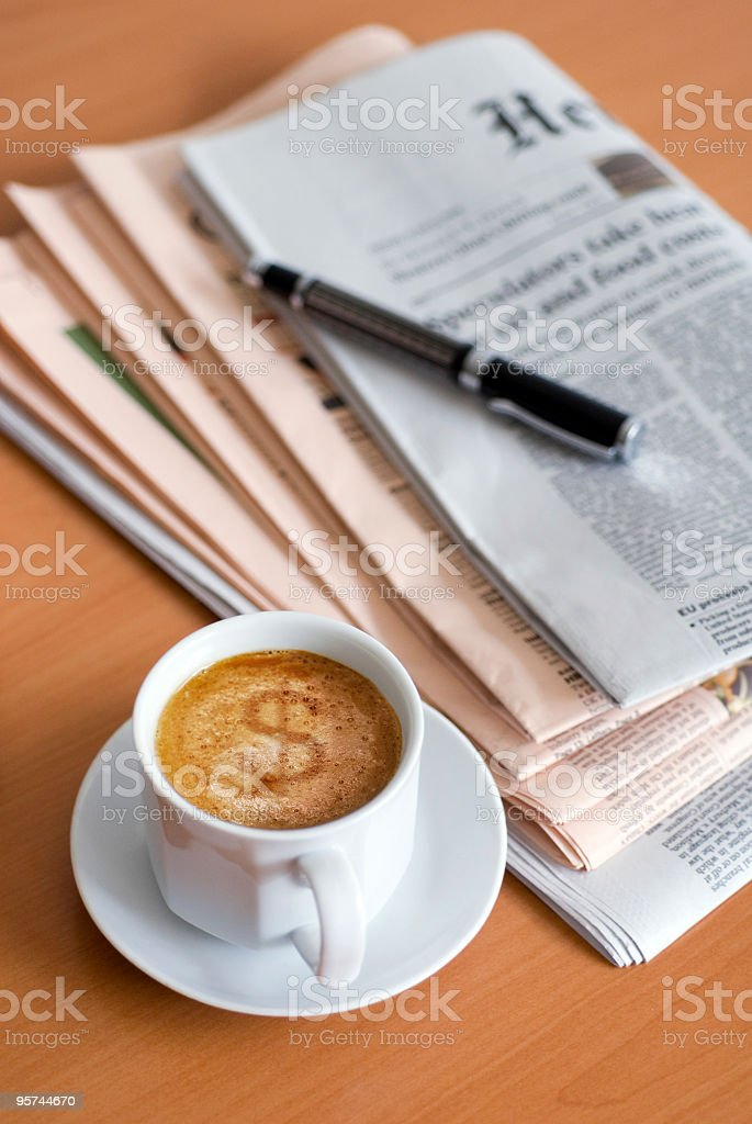 Cup of coffee with a dollar sign on it royalty-free stock photo