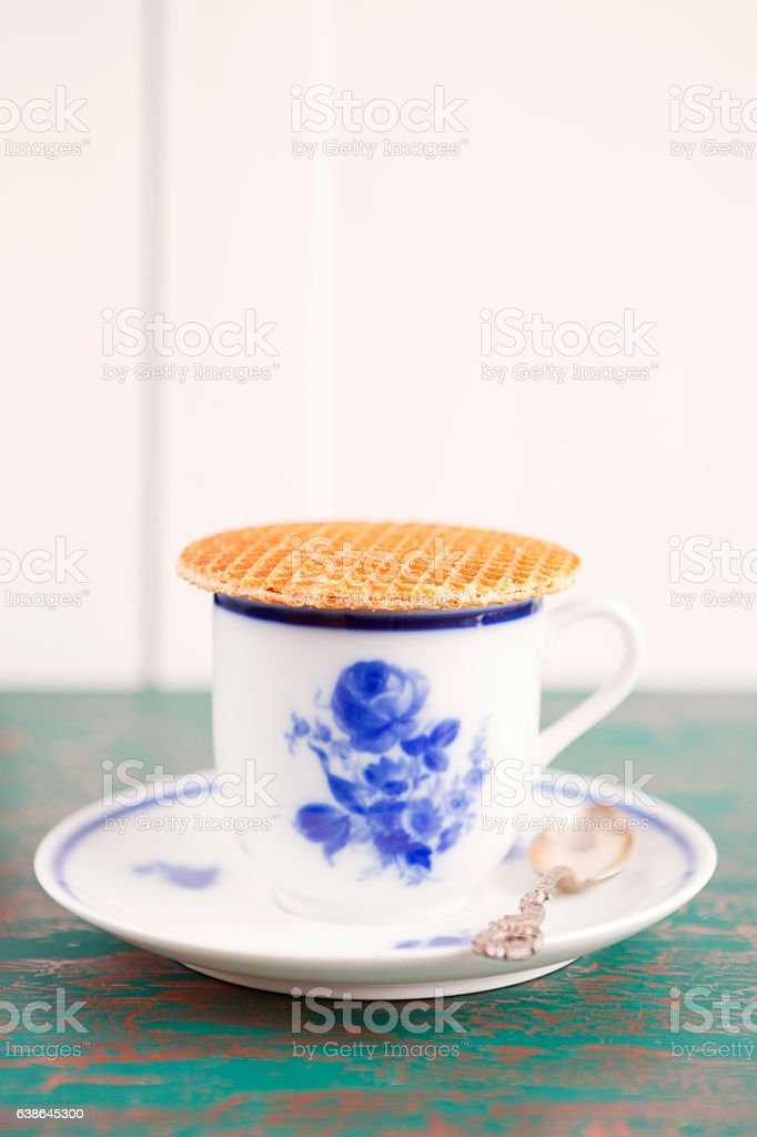 Cup of coffee with a Dutch stroopwafel cookie stock photo