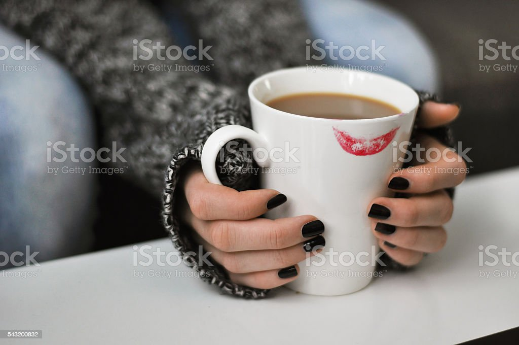 Cup of coffee with a lipstick mark stock photo