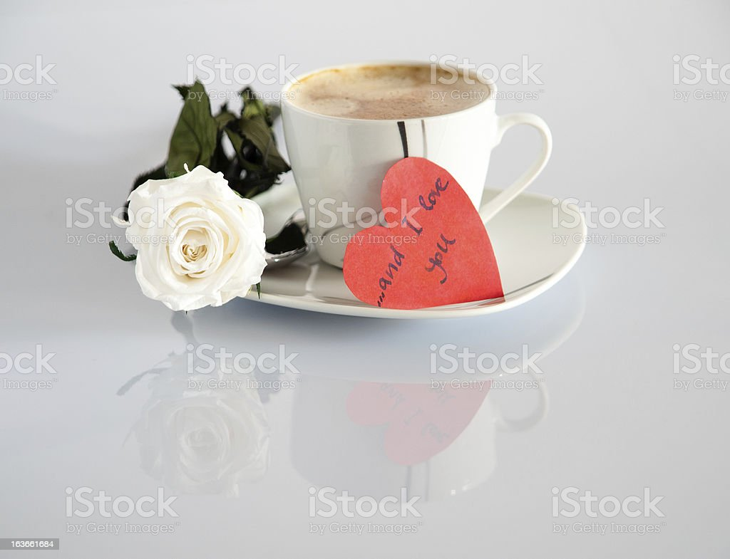 Cup of coffee with a rose royalty-free stock photo