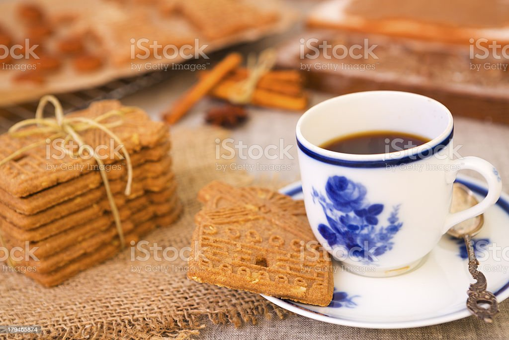 Cup of coffee with a typical Dutch speculaas cookie stock photo