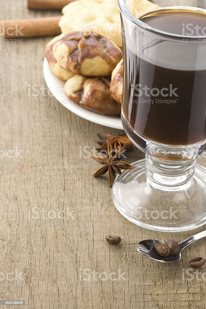 cup of coffee with beans and cakes on wood royalty-free stock photo