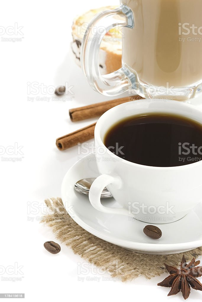 cup of coffee with beans and sweets isolated on white royalty-free stock photo