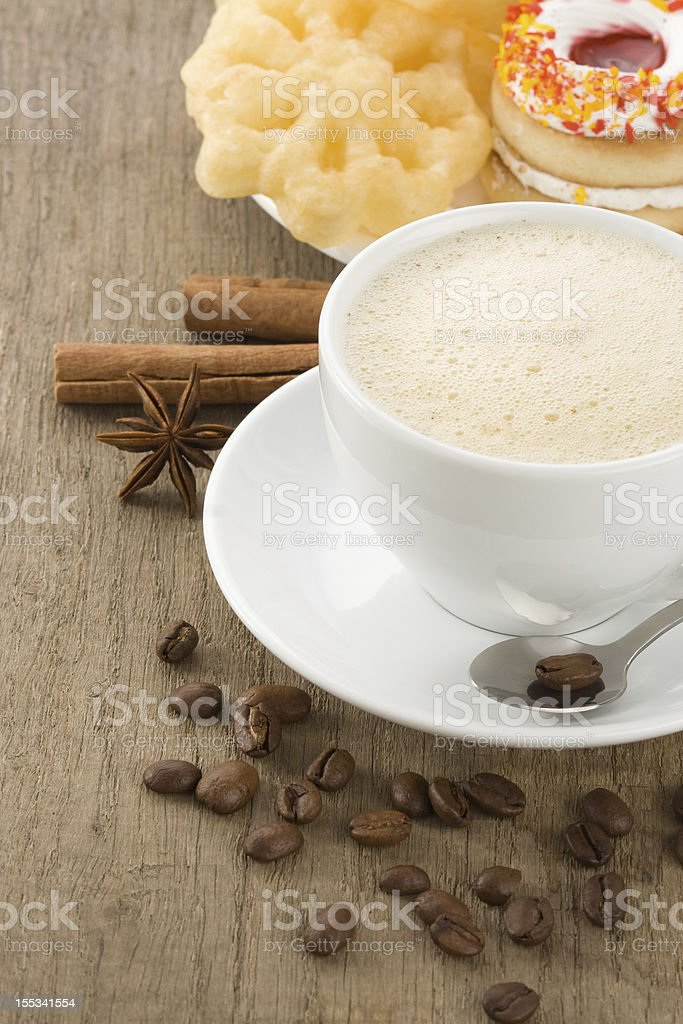 cup of coffee with beans and sweets royalty-free stock photo