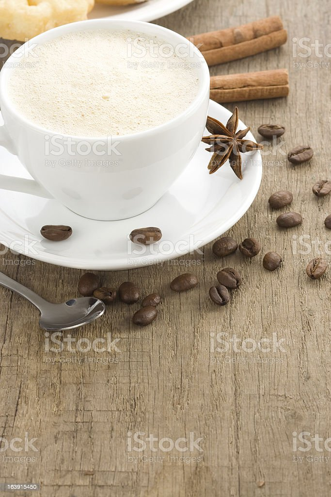 cup of coffee with beans on wood royalty-free stock photo