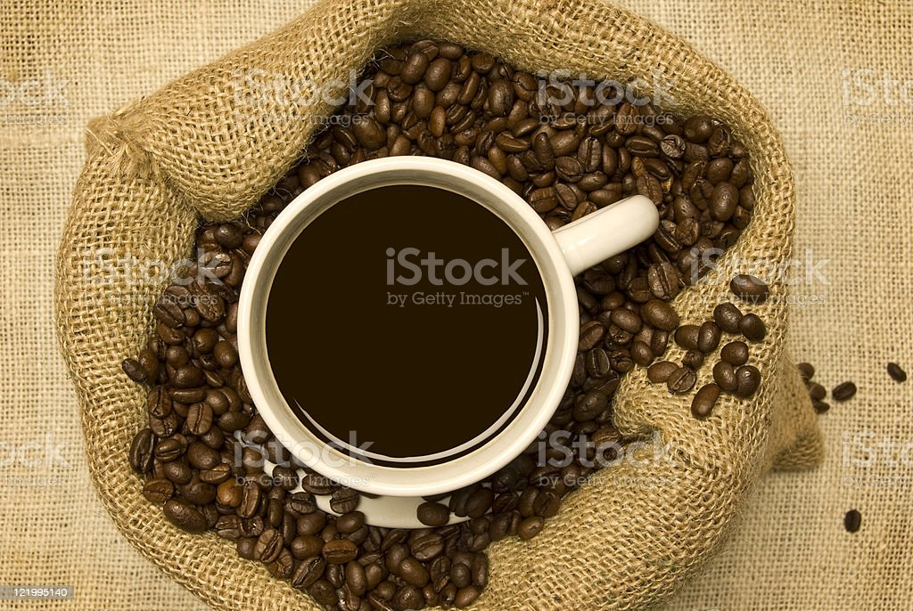 Cup of Coffee With Beans royalty-free stock photo