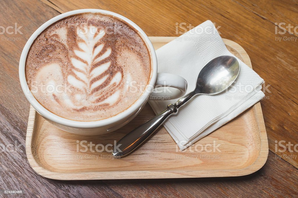 Cup of coffee with beautiful art stock photo