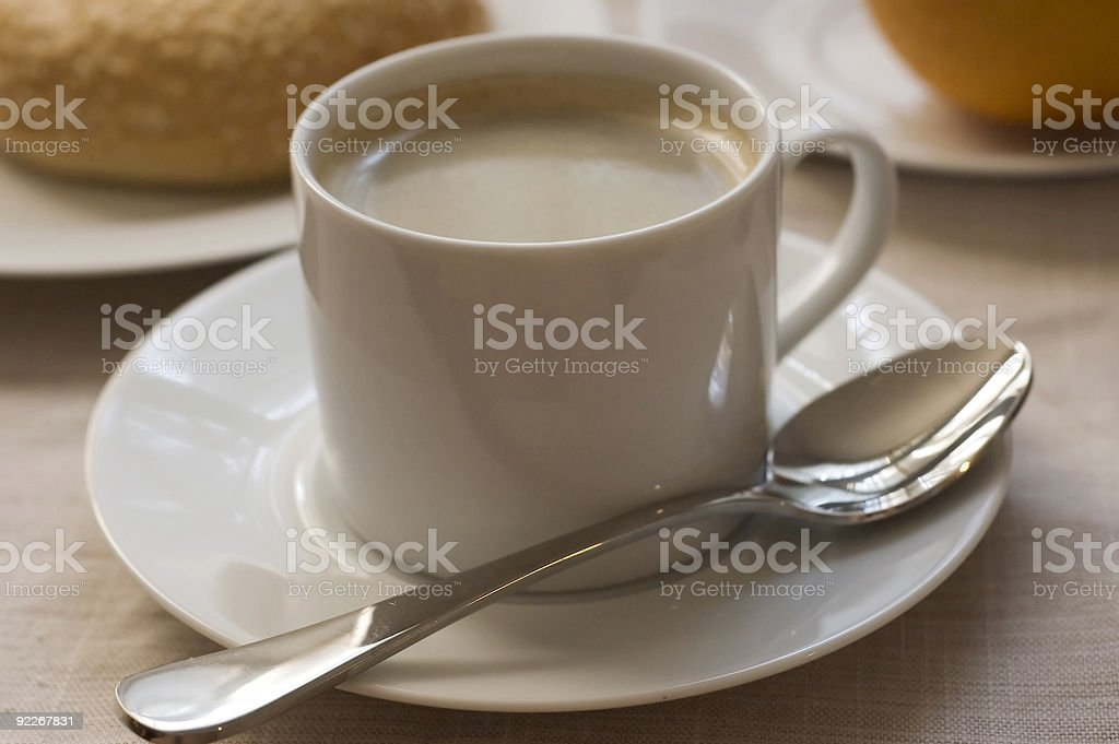 cup of coffee with breakfast in background stock photo