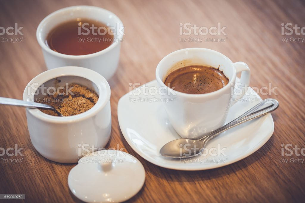 cup of coffee with brown sugar on wooden table stock photo