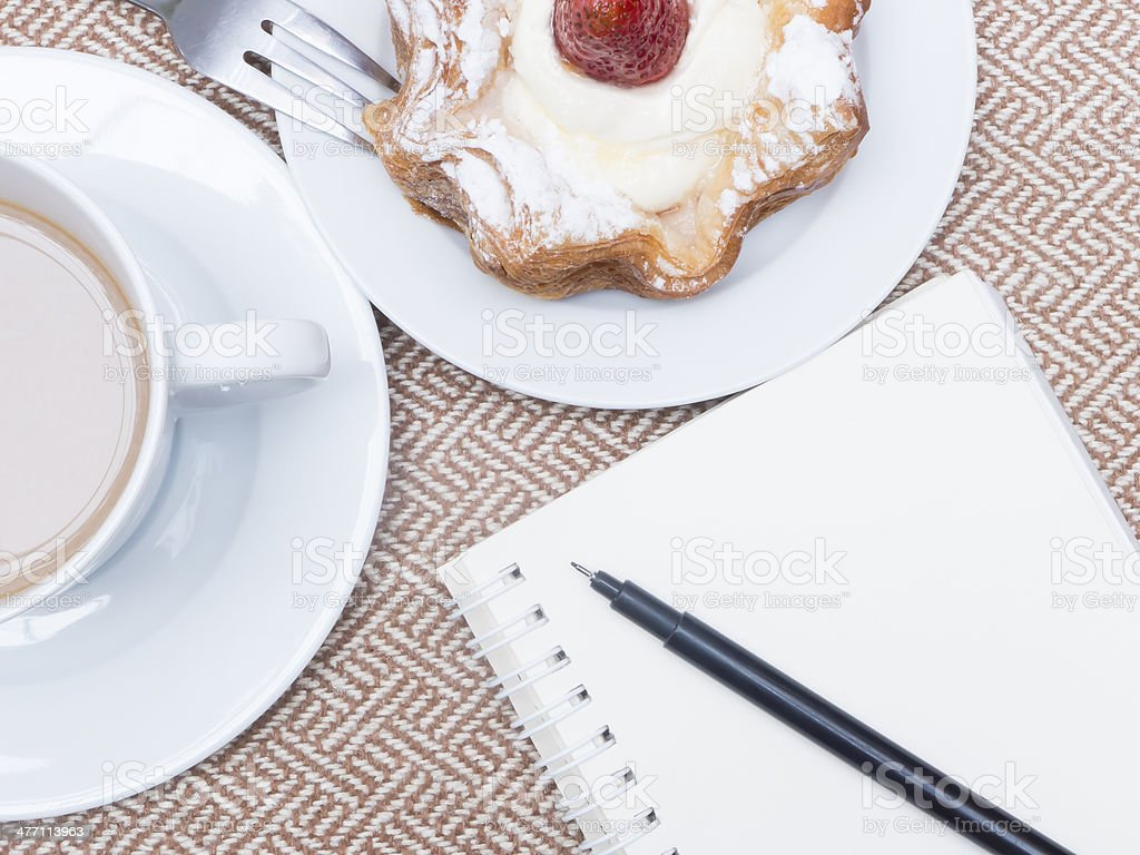 Cup of coffee with cake and notebook royalty-free stock photo