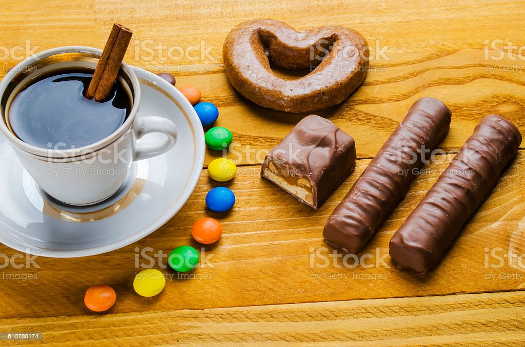 cup of coffee with candies stock photo