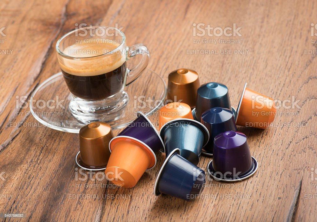 Cup of Coffee with Capsules, Nestle Nespresso Kaffeekapseln stock photo