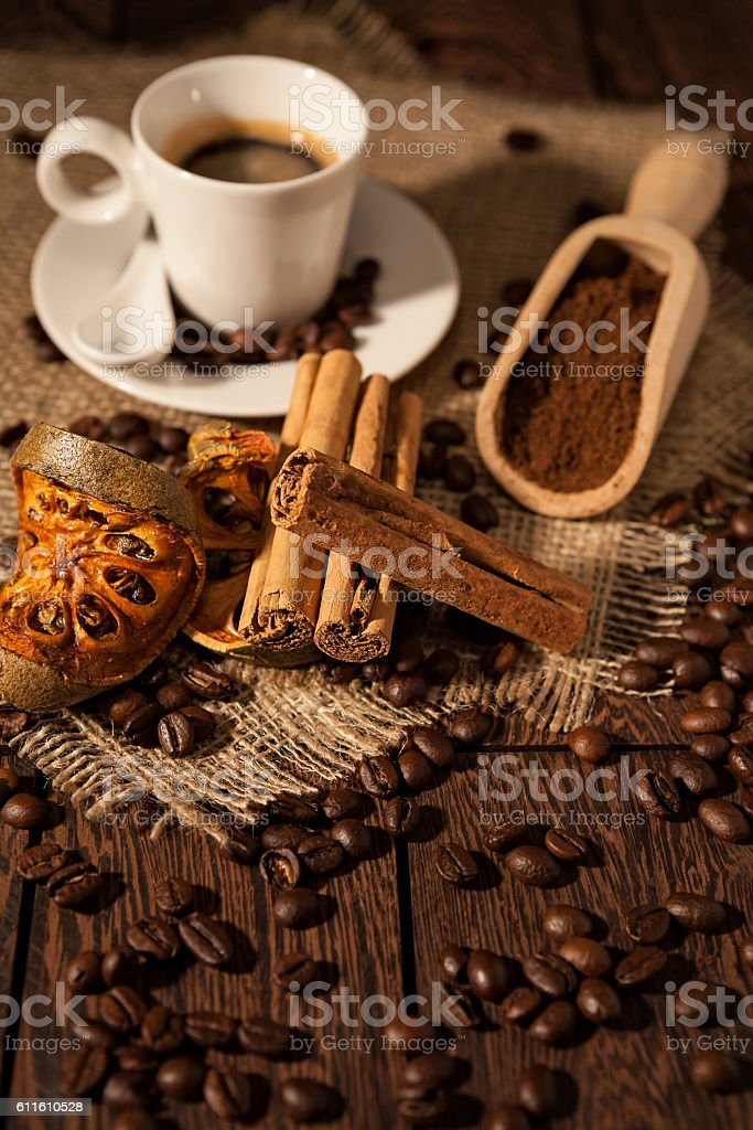 Cup of coffee with cinnamon and dried orange fruit stock photo