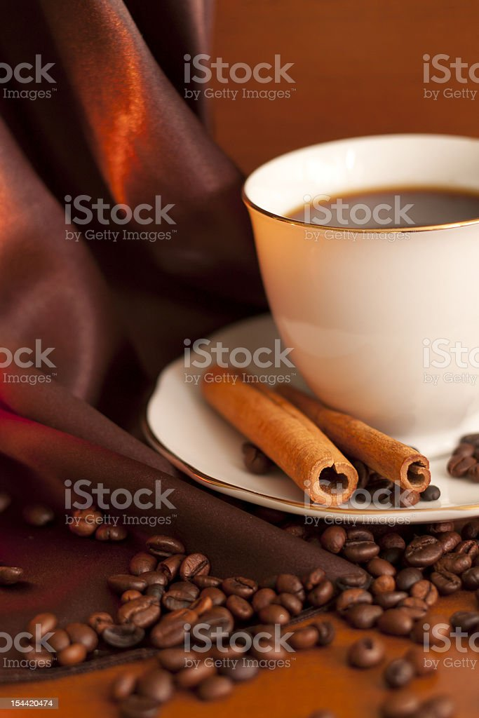 Cup of coffee with cinnamon in night royalty-free stock photo
