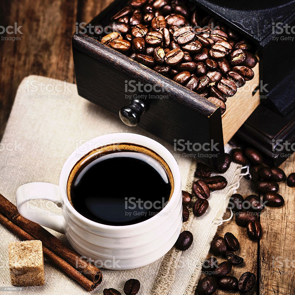 Cup of coffee with coffe beans and Cofee grinder stock photo