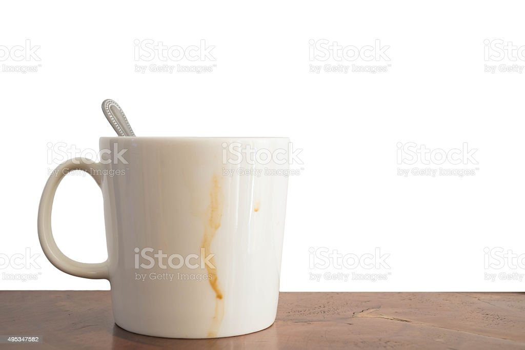 Cup of coffee with coffee stain on wood desk stock photo