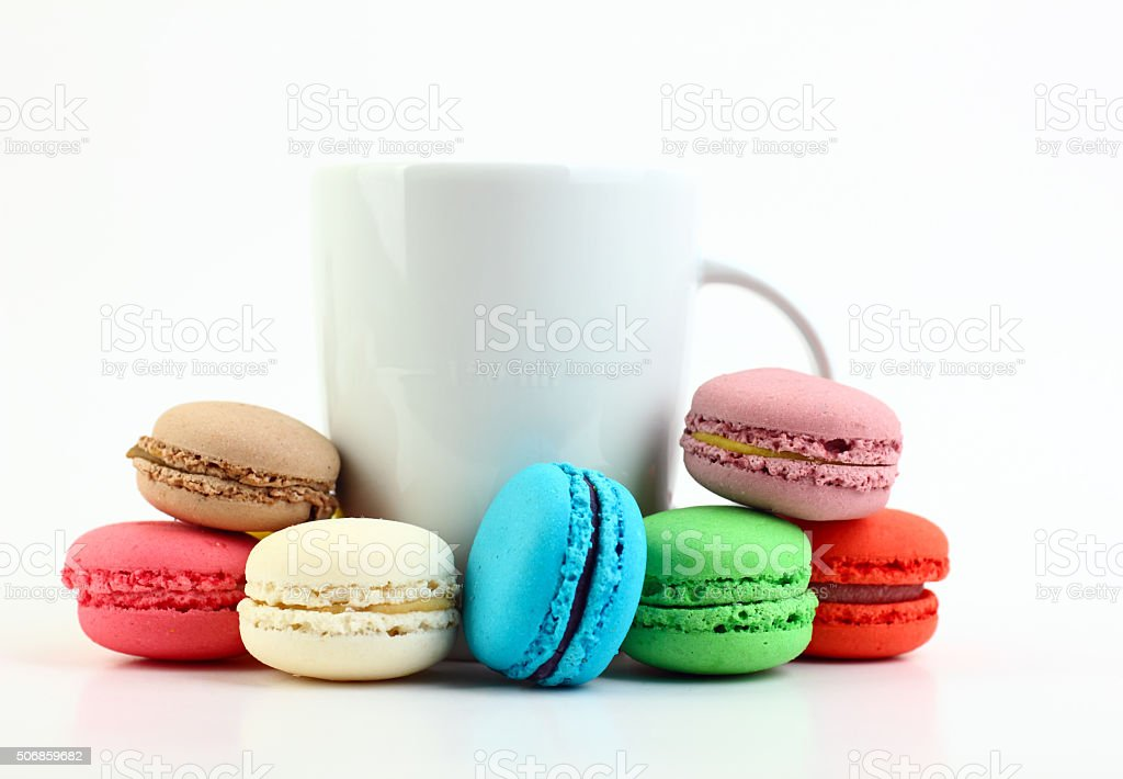 Cup of coffee with colorful macaroons stock photo