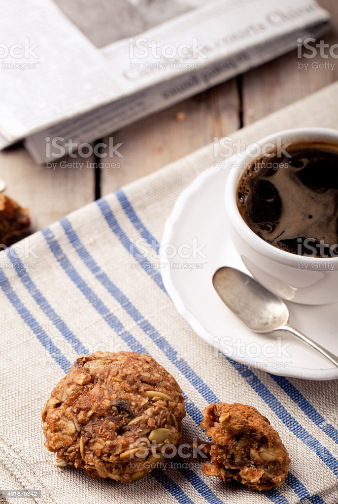 Cup of coffee with cookies and morning newspaper stock photo