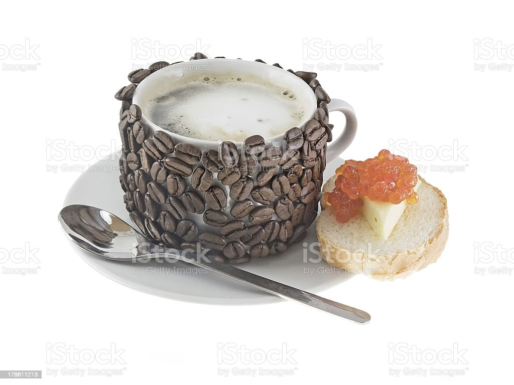Cup of coffee with cream, red caviar. Isolated royalty-free stock photo
