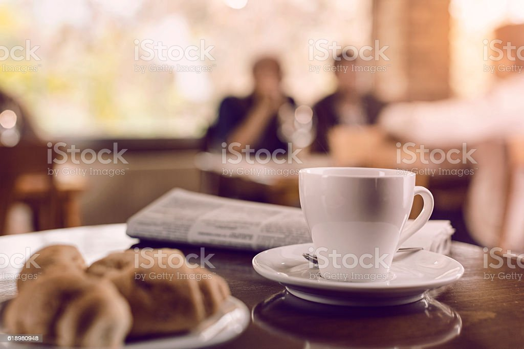 Cup of coffee with croissant stock photo