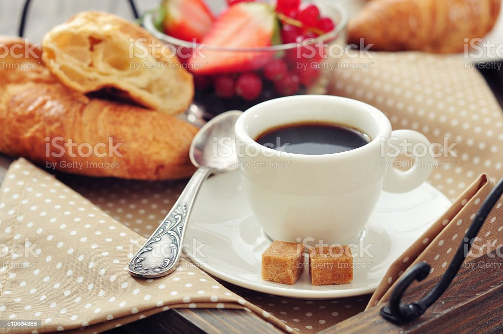 Cup of coffee with croissants stock photo