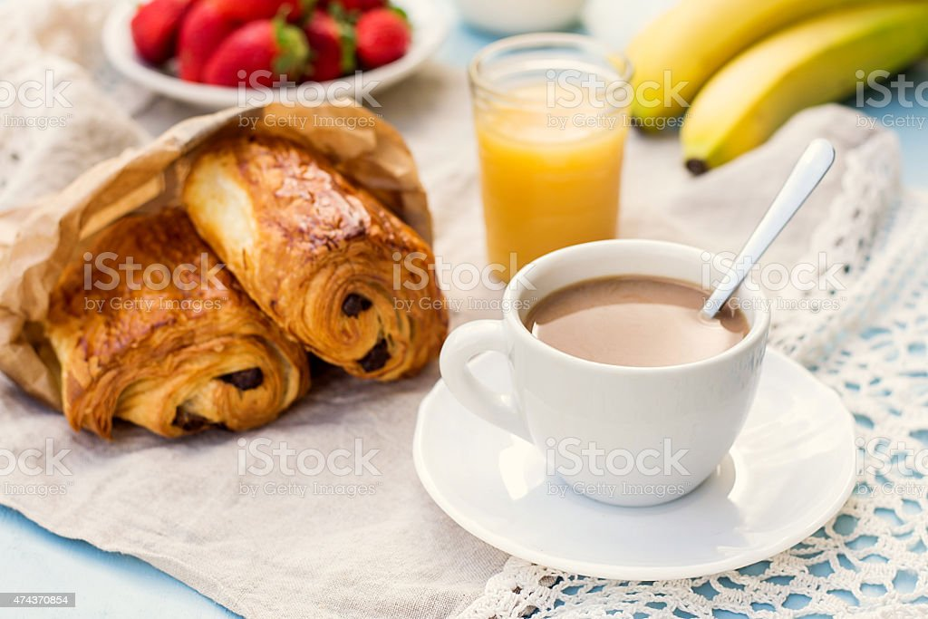 Cup of coffee with french croissant with chocolate stock photo