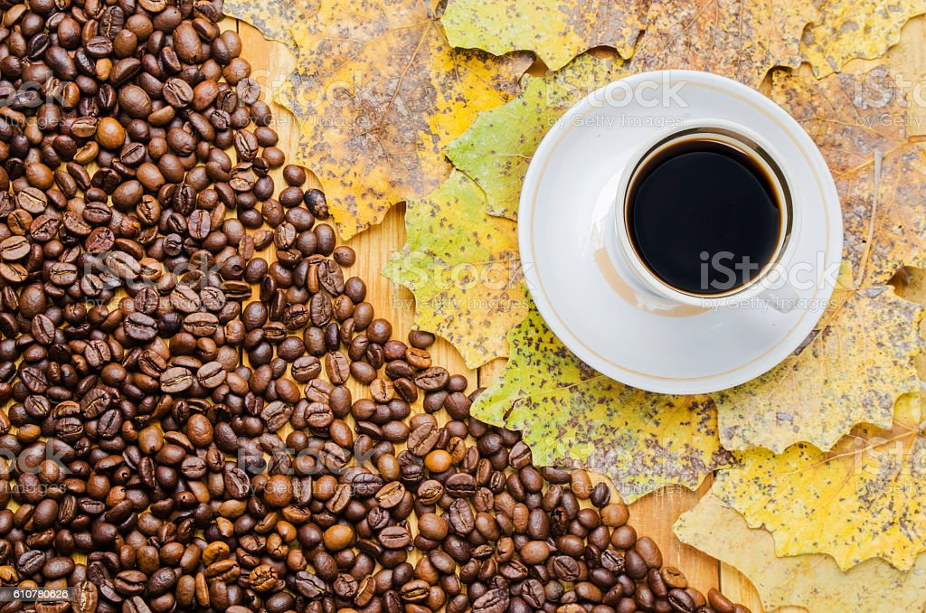 cup of coffee with grains on a table stock photo
