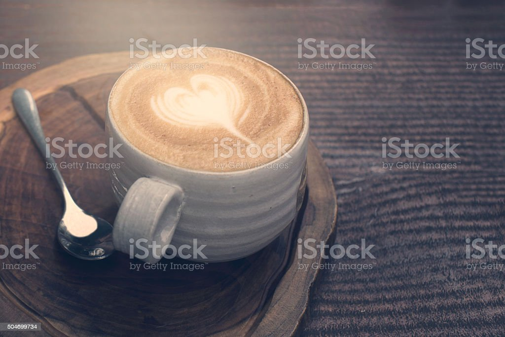 cup of coffee with heart pattern stock photo