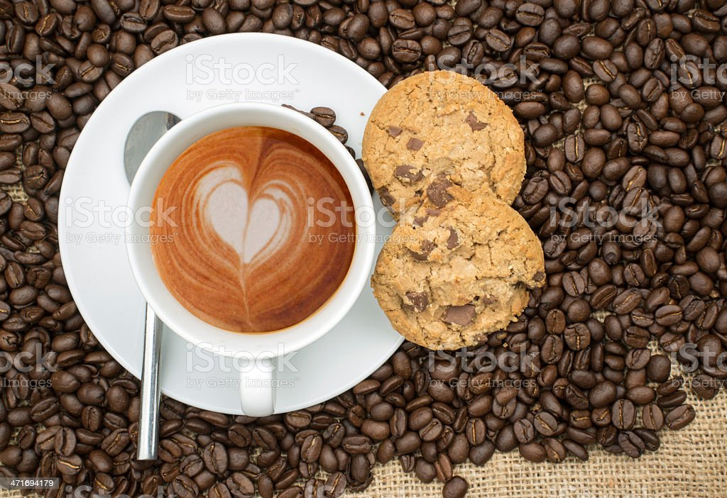 Cup of coffee with heart shape in foam royalty-free stock photo