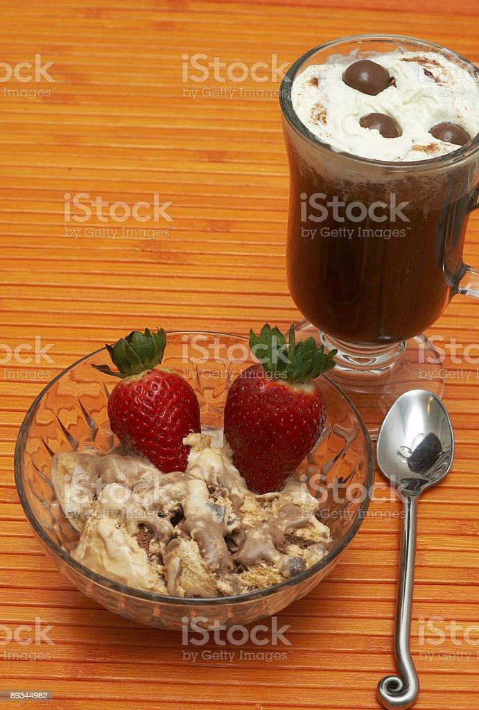Cup of coffee with ice-cream and strawberries royalty-free stock photo
