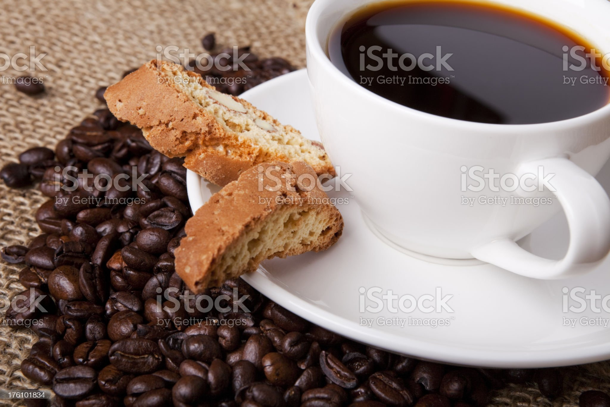 Cup of coffee with Italian cantuccini cookie on burlap cloth royalty-free stock photo