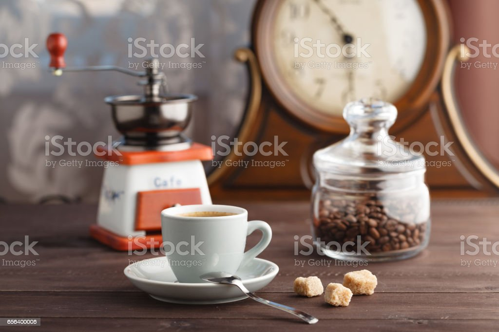 Cup of coffee with jar with coffee beans stock photo